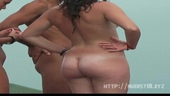 Raunchy teens nude at the beach Thumb