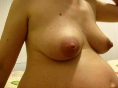 Pregnant woman show her naked body Thumb