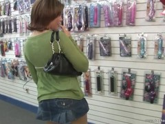 Naughty American girl Leigh uses a vibrator in public Thumb
