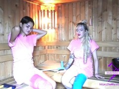 Fetisch-Concept.com - 2 girls with long cast leg in sauna Thumb