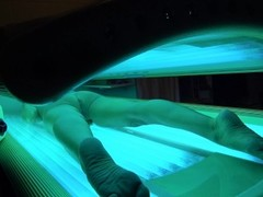 HOT WIFE WARMS UP BEFORE MAKING VIDEOS FOR PH IN TANNING BED Thumb