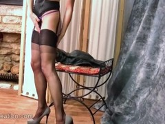 Watch as hot Milf Cindy strips off her soft black leather outfit to reveal her sexy thong nylons cor Thumb