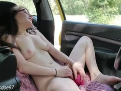 Fully nude and fucking myself in my car in public Thumb
