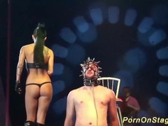 tattoed babe in a public bdasm sex show Thumb