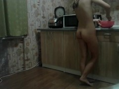 Hidden camera in the kitchen. Naked wife cooks breakfast Thumb
