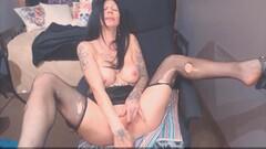 Tattooed MILF in sexy ripped stockings Thumb